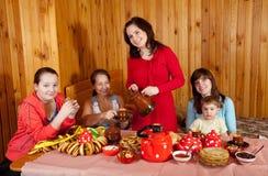Women  with child drinks tea Stock Photos