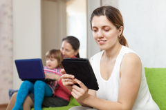 Women and child with electronic devices Stock Image