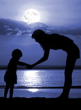 Women and child on moon night Royalty Free Stock Photos