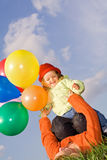 Women and child playing with balloons Stock Photo