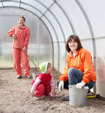 Women with child works at hothouse Stock Photos