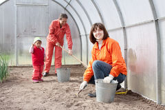 Women with child works at hothouse Royalty Free Stock Photo
