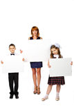 Women and children hold a poster Royalty Free Stock Photography
