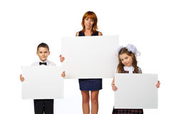 Women and children hold a poster Stock Images