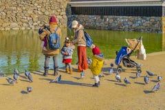 Women with Children, Matsumoto Castle, Japan. MATSUMOTO, JAPAN, JANUARY - 2019 - Two women with children at matsumoto castle park, matsumoto, japan stock images