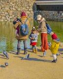 Women with Children, Matsumoto Castle, Japan. MATSUMOTO, JAPAN, JANUARY - 2019 - Two women with children at matsumoto castle park, matsumoto, japan royalty free stock images