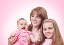 Women and children on pink Stock Images