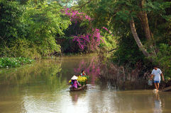 Women and children on rowboat with flower forTet in springtime Royalty Free Stock Images