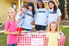 Women And Children Running Charity Bake Sale. Smiling Royalty Free Stock Photos