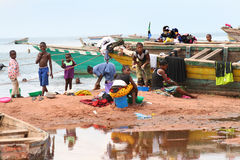 Women and children on the shore of Lake Tanganyika, Tanzania Stock Image