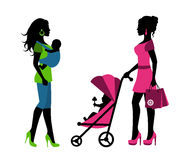 Women with children in a sling and stroller Stock Photos