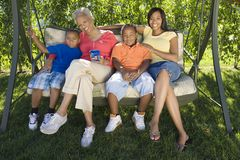 Women With Children On Swing stock image