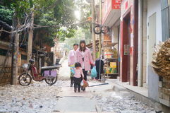 Women with children in the village alley Royalty Free Stock Image