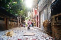 Women with children in the village alley Stock Photos