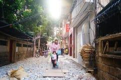 Women with children in the village alley Stock Photo