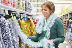 Women choose tinsel for Christmas Royalty Free Stock Photography