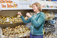 Women choose toys for Christmas tree in store Stock Photography
