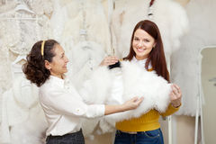 Women chooses bridal outfit at wedding store Royalty Free Stock Image