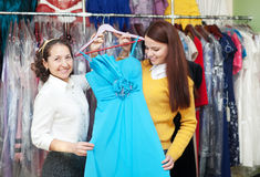 Women chooses evening gown at  store Stock Photos