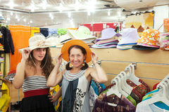 Women  chooses hat at  shop Stock Image