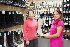 Women chooses high boots Royalty Free Stock Image