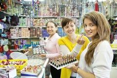 Women chooses   lipstick Stock Photos