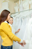 Women chooses white gown Stock Photos