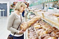 Women choosing bread in shop Stock Photography