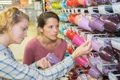 Women choosing cup in shop. Women choosing the cup in a shop Stock Photography