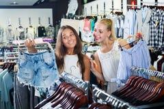 Women choosing jeans shorts Stock Photography