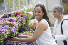 Women choosing plants Royalty Free Stock Photo