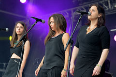 Women in the chorus of Skizophonic (band) performs at FIB Festival Stock Photo