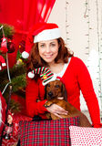 Women with chrismas dog Stock Photography