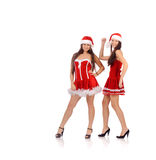 Women in Christmas costume Stock Images