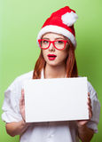 Women in christmas hat with board Stock Photography