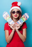 Women in christmas hat with flip flops Royalty Free Stock Image