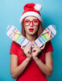 Women in christmas hat with flip flops Royalty Free Stock Photography