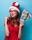 Women in christmas hat with flip flops Royalty Free Stock Photo