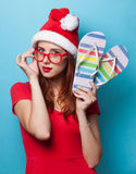 Women in christmas hat with flip flops Stock Images