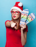 Women in christmas hat with flip flops Royalty Free Stock Photos