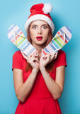 Women in christmas hat with flip flops Stock Photo