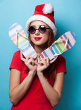 Women in christmas hat with flip flops Stock Image