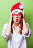 Women in christmas hat Royalty Free Stock Photos