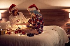 Women at Christmas Holidays.Happy gay couple having fun together