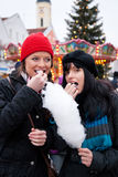 Women on Christmas market eating candy Stock Image