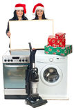 Women with Christmas offer at household appliances Royalty Free Stock Photos