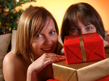 Women with Christmas presents Stock Images