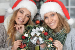 Women with Christmas wreath Royalty Free Stock Photography