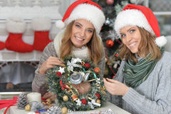 Women with Christmas wreath Royalty Free Stock Photo