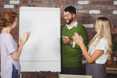 Women clapping for male colleague Royalty Free Stock Image